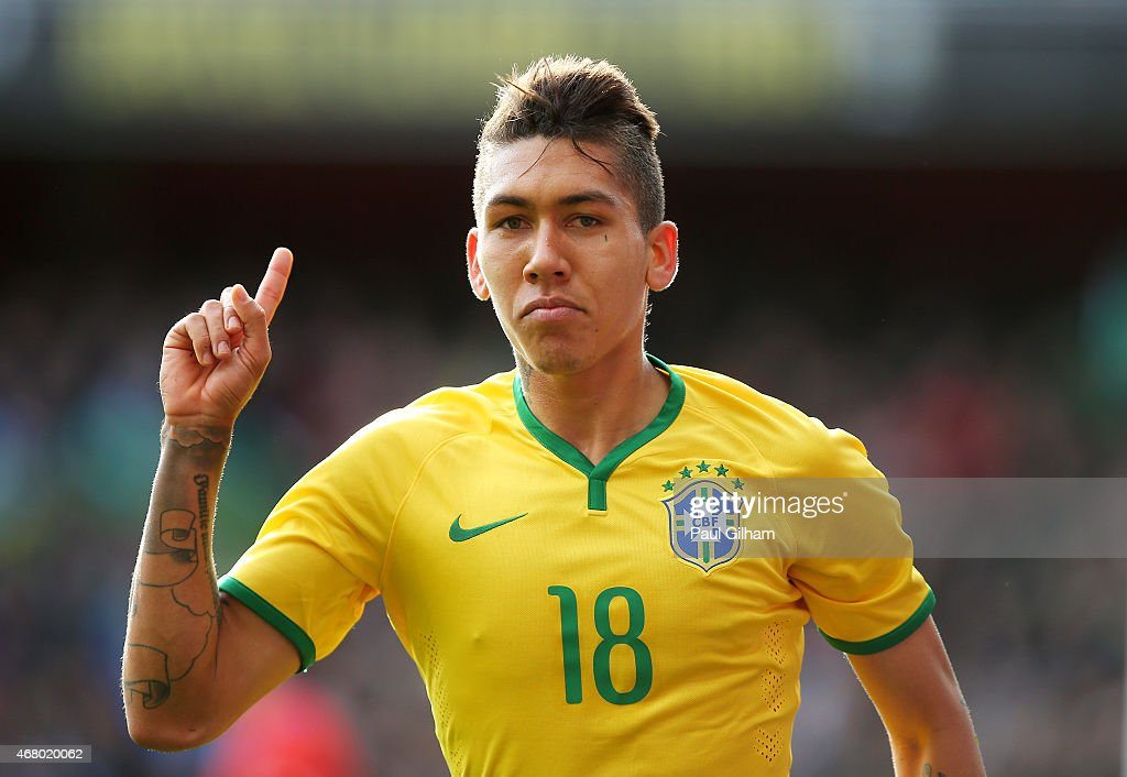 Firmino of Brazil celebrates after scoring the opening goal during the international friendly match between Brazil and Chile at the Emirates Stadium on March 29, 2015 in London, England.