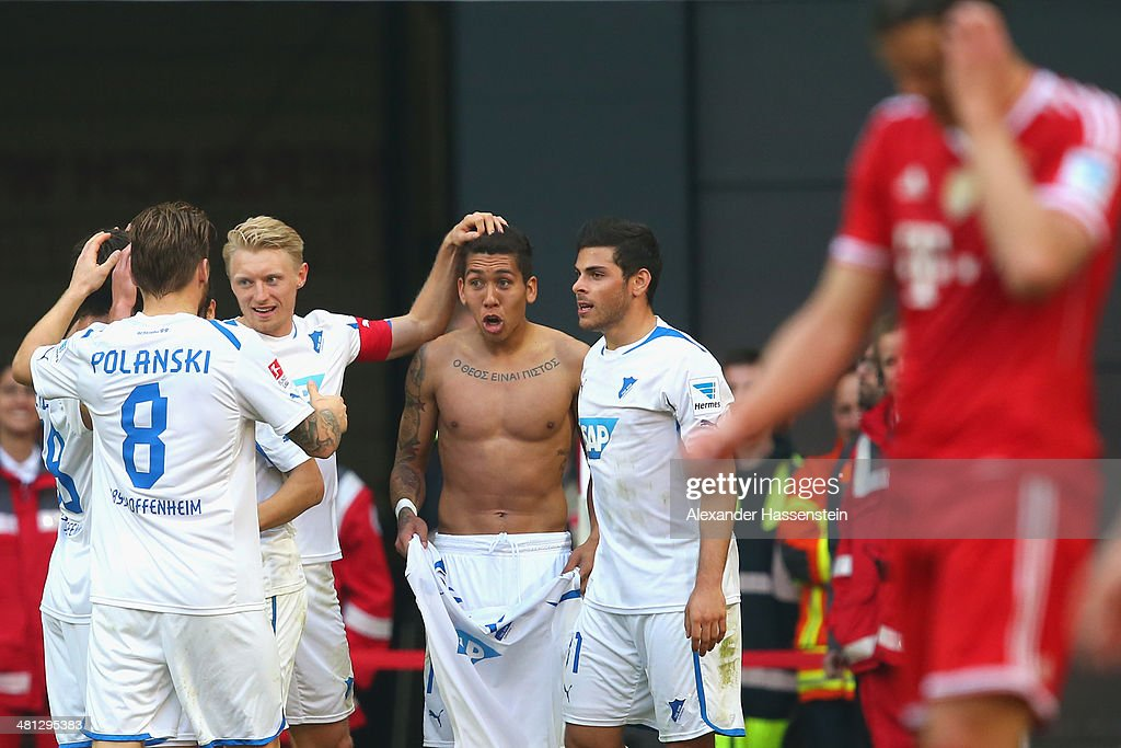 Firmino (C) of Hoffenheim celebrates scoring the 3rd team goal with his team mates during the Bundesliga match between FC Bayern Muenchen and 1899 Hoffenheim at Allianz Arena on March 29, 2014 in Munich, Germany.