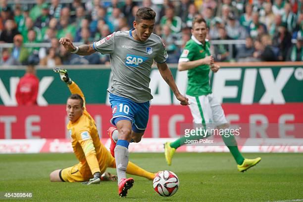 Firmino of Hoffenheim scores his team's first goal during the Bundesliga match between Werder Bremen and 1899 Hoffenheim at Weserstadion on August 30...