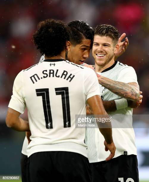 Firmino of Liverpool celebrate with his team mates Mohamed Salah and Alberto Moreno the 2nd goal during the Audi Cup 2017 match between Bayern...