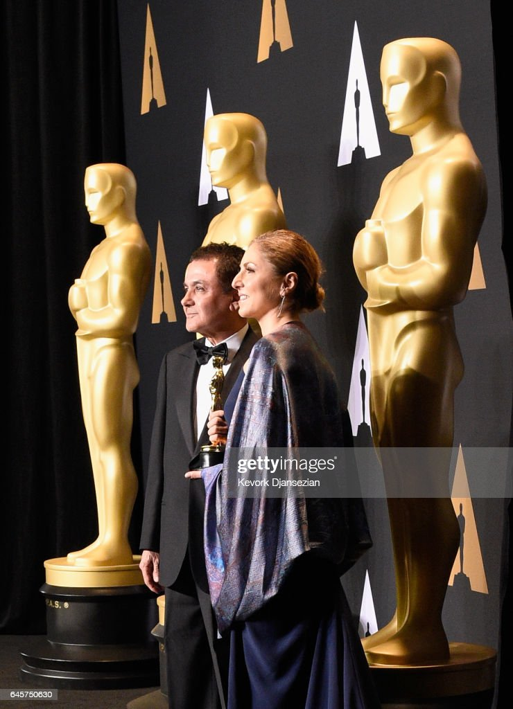 Firouz Naderi (L) and Anousheh Ansari, who accepted the Best Foreign Language Film award on behalf of director Asghar Farhadi, poses in the press room during the 89th Annual Academy Awards at Hollywood & Highland Center on February 26, 2017 in Hollywood, California.