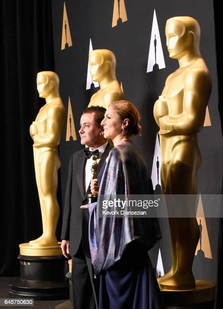 Firouz Naderi and Anousheh Ansari who accepted the Best Foreign Language Film award on behalf of director Asghar Farhadi poses in the press room...