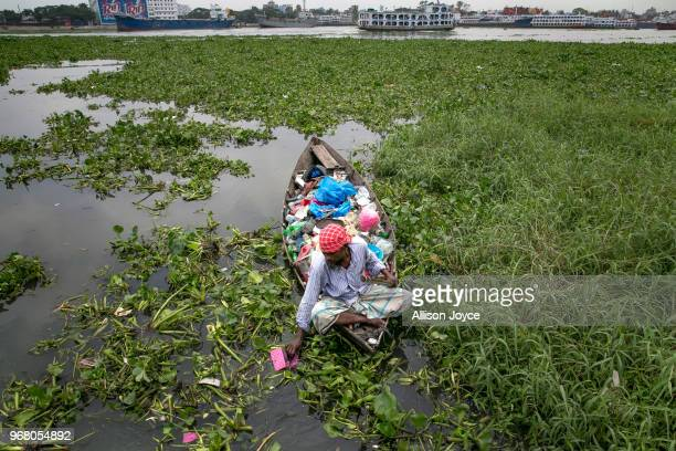 Firoz Milon collects waste on the Buriganga river on June 5 2018 in Dhaka Bangladesh He sells one kilo of waste for 20 taka and says he averages...