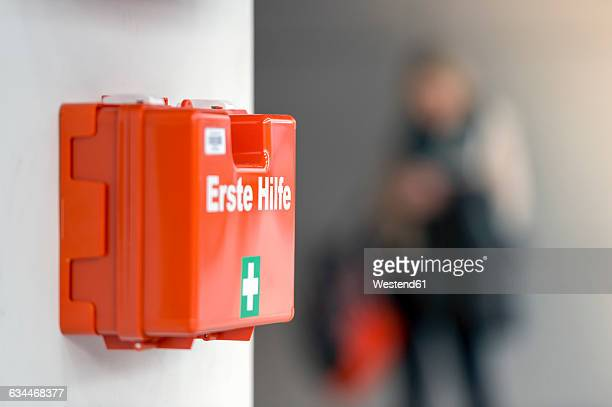 First aid box hanging on the wall