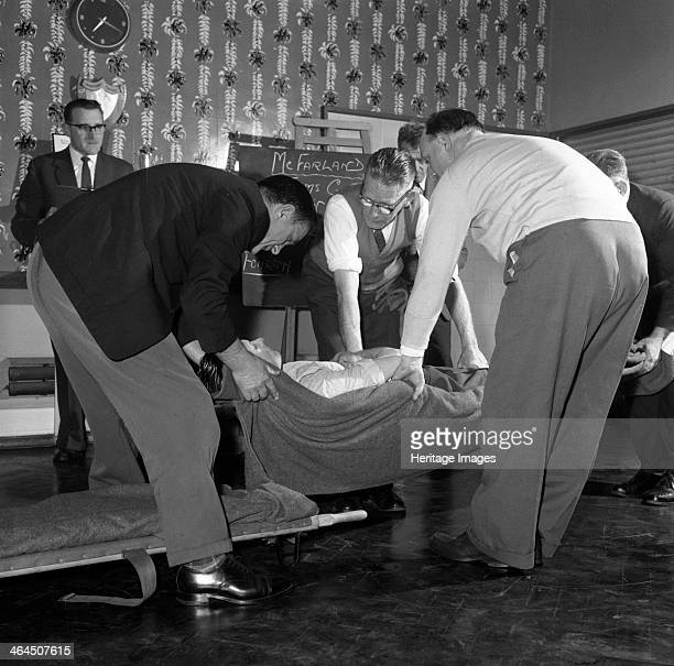 First aid competition Mexborough South Yorkshire 1961 A volunteer is lifted onto a stretcher during a first aid competition which was held by the...