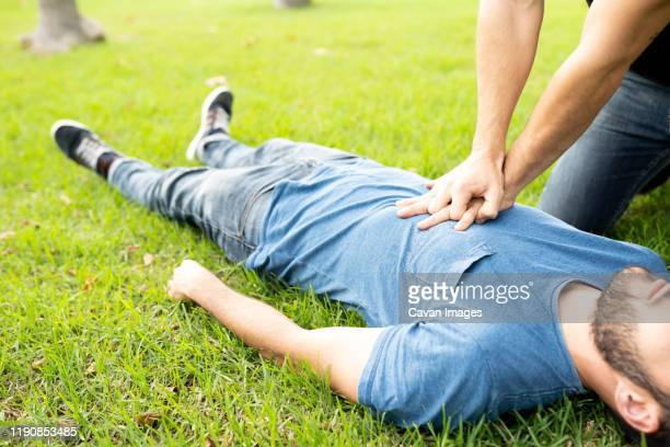 first aid emergency cpr rcp on heart attack man , resuscitation cardio - emergencies and disasters stock pictures, royalty-free photos & images