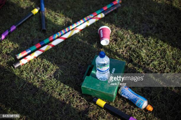 A first aid kit and quidditch brooms lay on the grass during the Crumpet Cup quidditch tournament on Clapham Common on February 18 2017 in London...