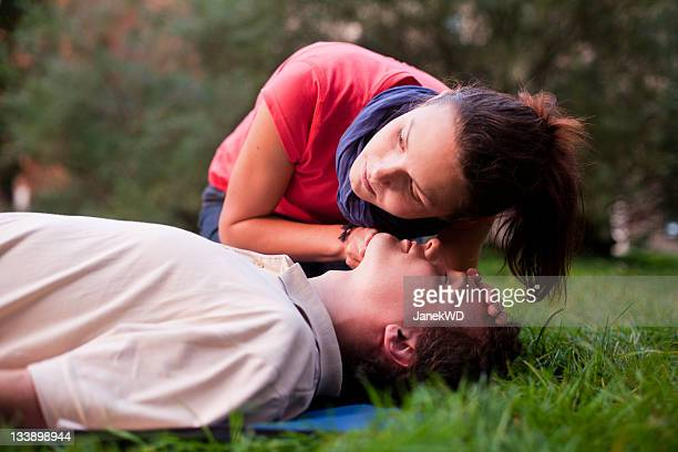 first aid - look, listen and feel for breathing. - first aid kit stock pictures, royalty-free photos & images