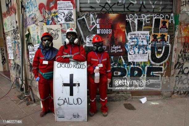 First aid medics during protests against president Piñera at Plaza Italia on December 2 2019 in Santiago Chile To reduce social unrest and violent...