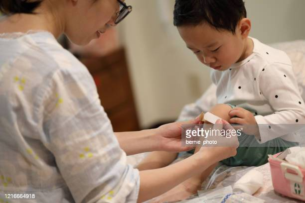 first aid - kids first aid kit stock pictures, royalty-free photos & images