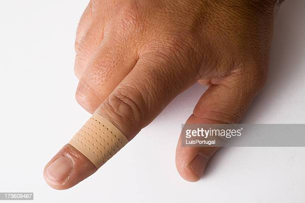 first aid - cut on finger stock photos and pictures
