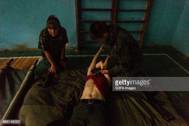 "First aid training. Steppen Wolves is a so-called ""military patriotic club"" for children living in the rebel controlled city of Ilovaisk, in Eastern..."