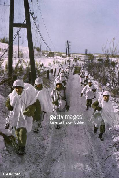 First Army Troops Wearing Snow Camouflage Capes Advance ArdennesAlsace Campaign Battle of the Bulge 1945