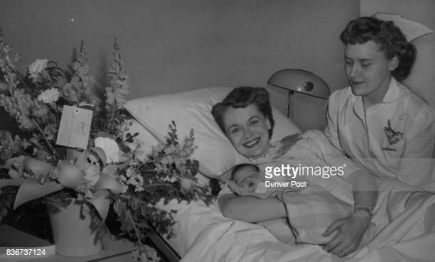 First arrival at the newly opened General Rose Memorial hospital is the 7pound 1ounce daughter of Mrs William Sherman shown above with Nurse Dolores...