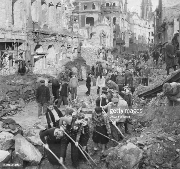 First attempts to clear the bombed Schlossstraße of Dresden and remove ruins The photo was taken in 1945 Especially the Allied air raids between 13...