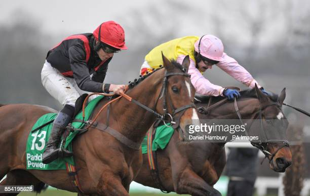 First Avenue ridden by Nathan Adams clears the last in second place but goes on to win The Paddy Power Imperial Cup Handicap Hurdle Race during Paddy...