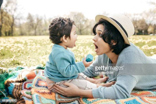 first baby's picnic - indian baby stock photos and pictures