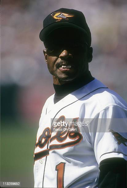 First Base Coach Al Bumbry of the Baltimore Orioles looks on from the coaches box during a Major League Baseball game circa 1995 at Camden Yards in...