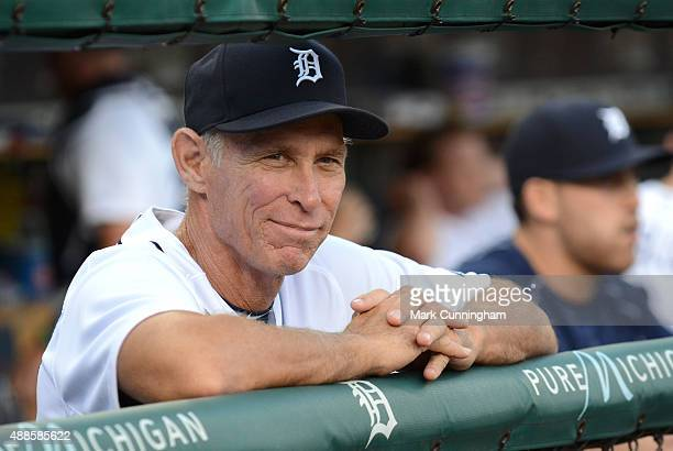 First base coach Alan Trammell of the Detroit Tigers looks on from the dugout during the game against the Texas Rangers at Comerica Park on August 22...