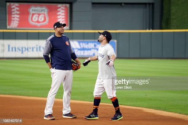First base coach Alex Cintron and Jose Altuve of the Houston Astros talk during batting practice prior to Game 4 of the ALCS against the Boston Red...