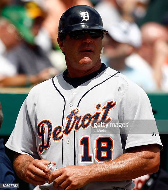 First base coach Andy Vanslyke of the Detroit Tigers enjoys a laugh prior to the Grapefruit League Spring Training game against the Pittsburgh...