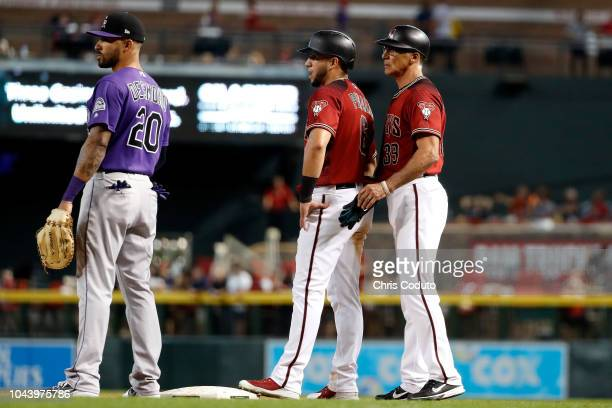 First base coach Dave McKay of the Arizona Diamondbacks talks with David Peralta during the bottom of the eighth inning at Chase Field against the...