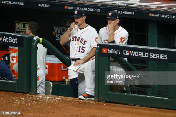 First base coach Don Kelly and manager AJ Hinch of the Houston Astros look on against the Washington Nationals during the seventh inning in Game Six...