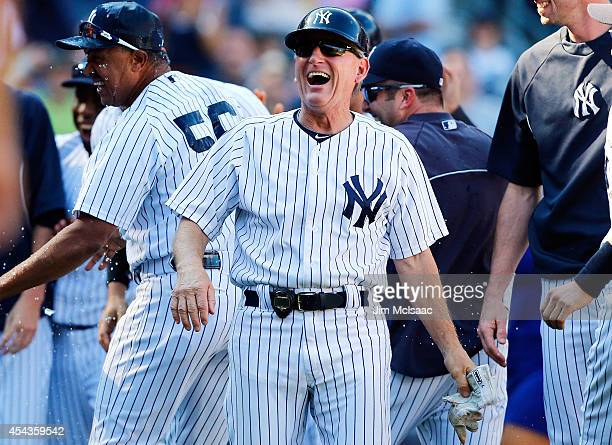 First base coach Mick Kelleher of the New York Yankees celebrates against the Chicago White Sox at Yankee Stadium on August 24 2014 in the Bronx...