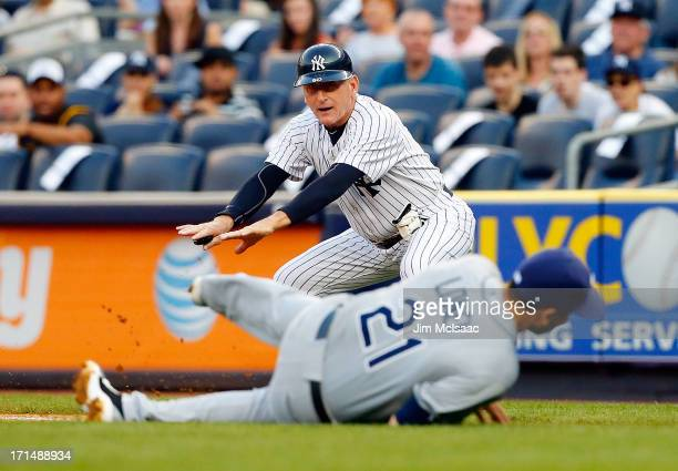 First base coach Mick Kelleher of the New York Yankees in action against the Tampa Bay Rays at Yankee Stadium on June 21 2013 in the Bronx borough of...