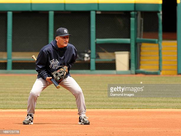 First base coach Mick Kelleher of the New York Yankees watches batting practice from the infield prior to a game against the Cleveland Indians on...