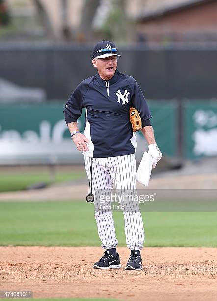 First base coach Mick Kelleher of the New York Yankees watches batting practice during spring training at George M Steinbrenner Field on February 21...