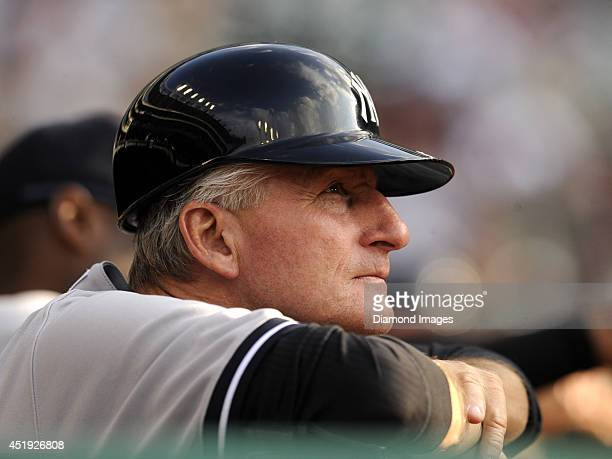 First base coach Mick Kelleher of the New York Yankees watches the action from the dugout during a game against the Cleveland Indians on July 7 2014...