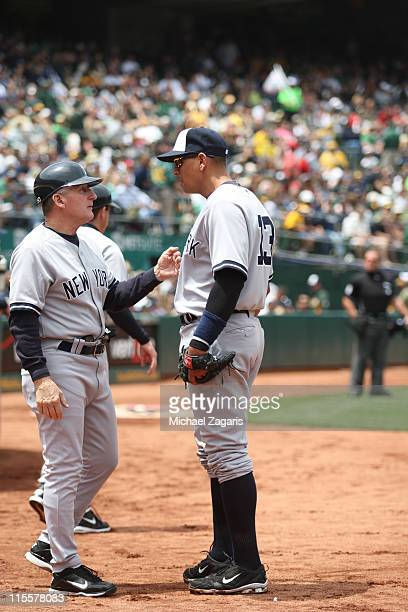 First Base Coach Mick Kelleher talks with Alex Rodriguez of the New York Yankees on the field during the game against the New York Yankees at the...