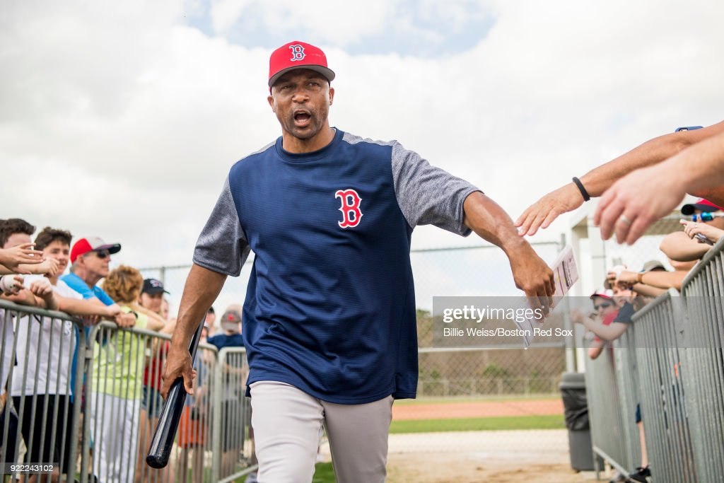 First base coach Tom Goodwin of the Boston Red Sox high fives fans during a team workout on February 21, 2018 at jetBlue Park at Fenway South in Fort Myers, Florida .