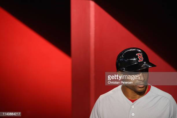 First base coach Tom Goodwin of the Boston Red Sox stands in the dugout before the MLB game against the Arizona Diamondbacks at Chase Field on April...