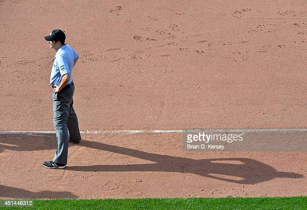 First base umpire John Tumpane stands on the field during the seventh inning of the game between the Chicago Cubs and the Pittsburgh Pirates at...
