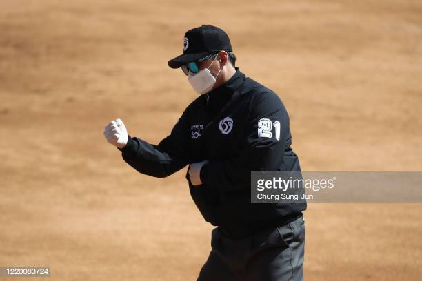 First base umpire Lee Gesung wears a mask during the preseason game between LG Twins and Doosan Bears at Jamsil Baseball Stadium on April 21 2020 in...