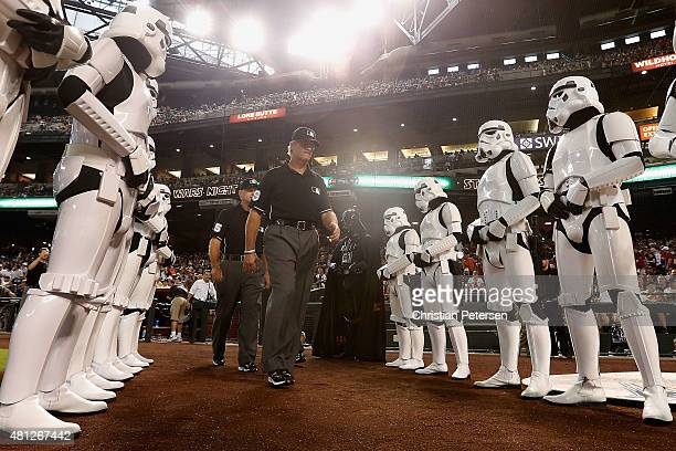 First base umpire Paul Nauert walks past Darth Vader and Stormtroopers in honor of 'Star Wars' night before the MLB game between the Arizona...