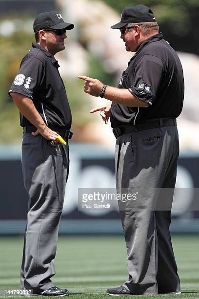 First base umpire Wally Bell points at second base umpire Brian Knight during the Los Angeles Angels of Anaheim game against the Toronto Blue Jays on...