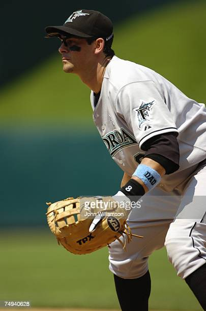 First baseman Aaron Boone of the Florida Marlins looks to home plate as the pitch is delivered during the game against the Kansas City Royals at...