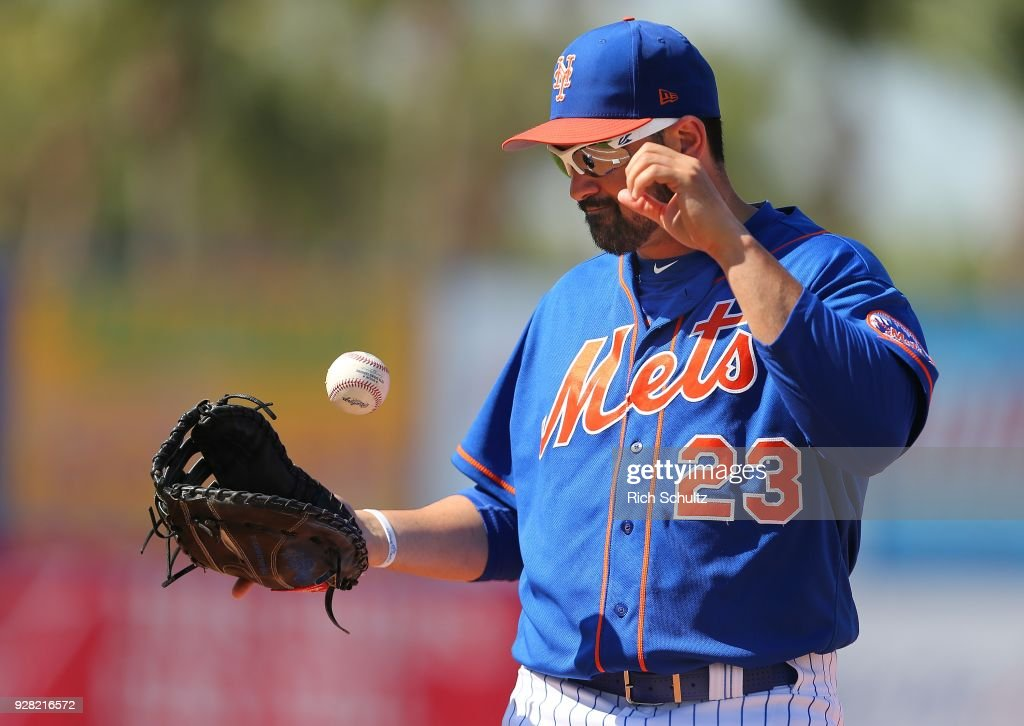 First baseman Adrian Gonzalez #23 of the New York Mets flips the ball into his glove after failing to scoop up a low throw from third baseman Todd Frazier #21 on a ball hit by Jake Marisnick #6 of the Houston Astros during the fifth inning of a spring training game at First Data Field on March 6, 2018 in Port St. Lucie, Florida. The Mets defeated the Astros 9-5.