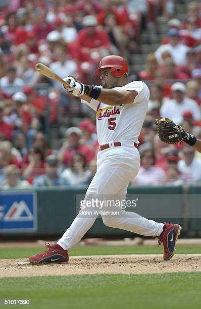 First baseman Albert Pujols of the St Louis Cardinals bats during the MLB game against the Florida Marlins at Busch Stadium on May 16 2004 in St...