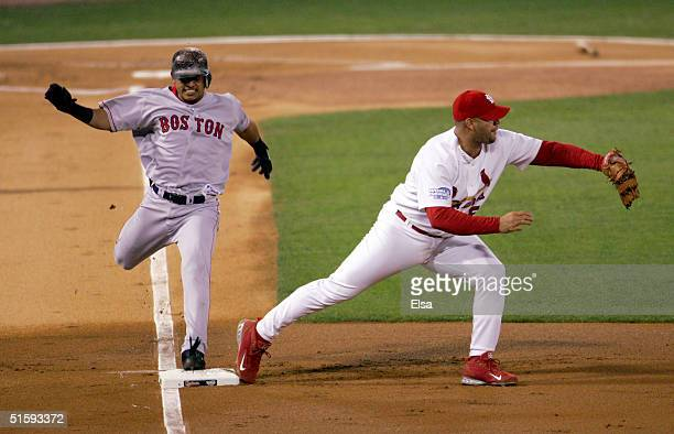 First baseman Albert Pujols of the St Louis Cardinals catches the throw from third base as batter Orlando Cabrera of the Boston Red Sox is called out...