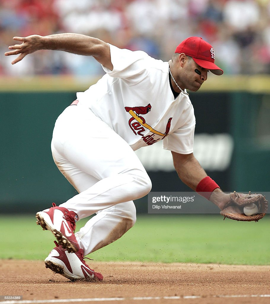 First baseman Albert Pujols #5 of the the St. Louis Cardinals fields a ball against the Atlanta Braves on August 6, 2005 at Busch Stadium in St. Louis, Missouri. The Braves defeated the Cardinals 8-1.