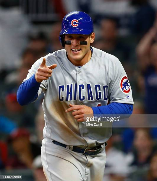 First baseman Anthony Rizzo of the Chicago Cubs reacts after stealing home to score in the seventh inning during the game against the Atlanta Braves...
