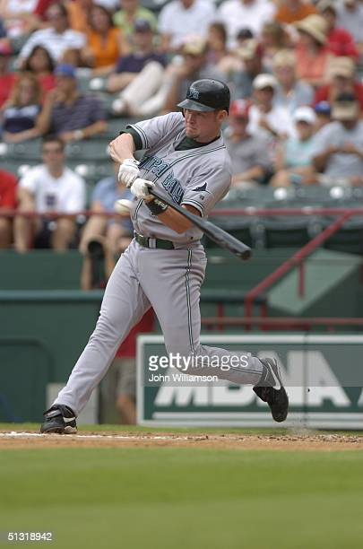 First baseman Aubrey Huff of the Tampa Bay Devil Rays bats during the MLB game against the Texas Rangers at Ameriquest Field in Arlington on August...