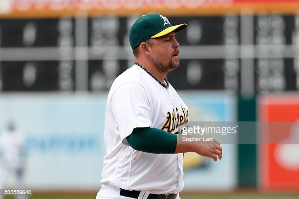 First baseman Billy Butler of the Oakland Athletics looks on after committing an error during the ninth inning against the New York Yankees at Oco...