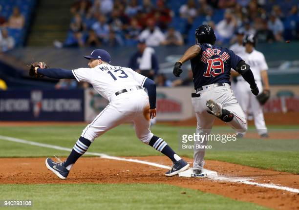 First baseman Brad Miller of the Tampa Bay Rays hauls in the throw from shortstop Adeiny Hechavarria to complete the double play with the out on...