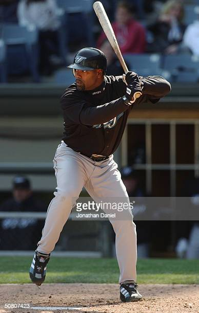 First baseman Carlos Delgado of the Toronto Blue Jays at bat during the game against the Chicago White Sox on May 2, 2004 at U.S. Cellular Field in...