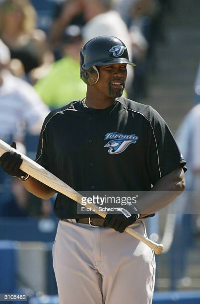 First baseman Carlos Delgado of the Toronto Blue Jays walks up to the plate during the Spring Training game against the New York Yankees on March 6...